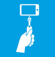 hand holding a selfie stick with mobile phone icon vector image vector image