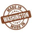 made in washington brown grunge round stamp vector image vector image