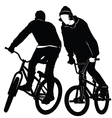 Teenagers riding a BMX bicycle vector image vector image