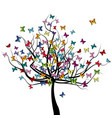 tree with colored butterflies flying around it vector image vector image