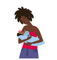 a dark-skinned young woman feeds her child vector image vector image