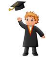 happy boy in black graduation gown vector image