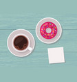 top view table with cup of coffee and donut vector image