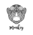 Monkey head with ethnic motifs vector image vector image