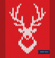 deer head knitted pattern on red background vector image vector image