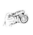 hand drawn of photographer holding camera on white vector image
