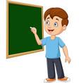 cartoon schoolboy writing on blackboard vector image