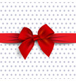 red gift bow with ribbon on polka dot background vector image vector image