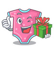 with gift cartoon baby clothes for the newborn vector image