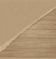 torn brown texturing paper over a wooden wall vector image vector image