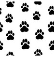 ink hand drawn seamless pattern with dog paws vector image
