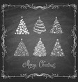 set christmas trees on chalk board vector image