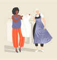 two young women choose dresses vector image