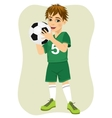 Cute teenager boy holding soccer ball vector image vector image