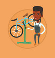 african bicycle mechanic working in repair shop vector image vector image