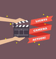 hands holding movie clapper board vector image vector image