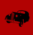 black car on a hazy red background vector image vector image