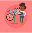 african bicycle mechanic working in repair shop vector image vector image