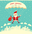 Santa Claus on parachute flying in winter blue sky