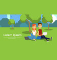 city park couple sitting green lawn using laptop vector image
