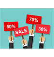 hands holding discount and sale signs vector image vector image