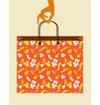 hand holding baby shopping bag with toy and cloth vector image vector image
