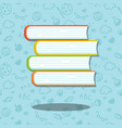 Stack of four books on blue background with
