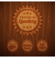 Badges on wooden background vector image vector image