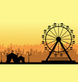 at sunset amusement park scenery silhouette vector image vector image