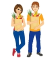 Happy couple carrying grocery paper bags vector image