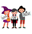 group of children in halloween party costumes vector image vector image