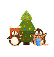 penguins in hat and scarf near christmas tree vector image vector image