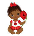 cute african american baby girl holding poppy