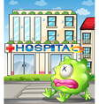 A sick monster in front of the hospital vector image vector image