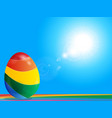 striped easter egg on rainbow over blue sky vector image vector image