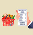checking a check from a grocery store full basket vector image vector image