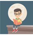 little boy reading a book on the roof of the house vector image vector image