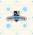photographer logo on seamless pattern camera vector image vector image