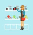 young blond woman choosing a meat grinder in home vector image vector image