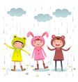 Kids wearing colorful raincoats and boots playing vector image vector image
