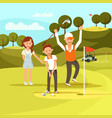 joyful boy aiming to hit golf ball hit it in hole vector image vector image
