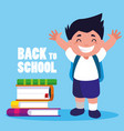 little student boy with school books vector image