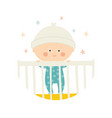 cute baby 1 year old standing in crib baby shower vector image vector image