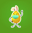 yellow decorated egg with rabbit ears in medical vector image vector image