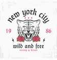 new york slogan typography with tiger and rose vector image vector image