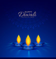 burning diya on blue background for happy diwali vector image vector image