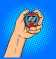 hand with stopwatch pop art vector image
