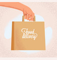 courier outstretched hand holding craft paper bag vector image