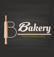 bakery rolling pin black background image vector image