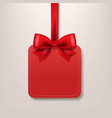 red paper sale label with red silk ribbon vector image